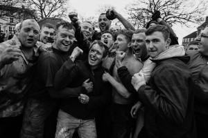 Image ©Licensed to i-Images Picture Agency. 09/02/2016. Sedgefield, County Durham, United Kingdom. People take part in the annual Sedgefield Shrove Tuesday Ball Game. An Easter tradition where a small leather ball is fought over for three hours. Pictured is the winner - Daz Clemmet. Picture by Tom Banks / i-Images